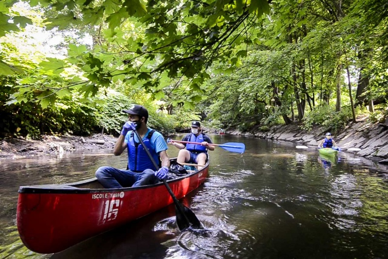 Christian Murphy, Ecology Coordinator for the Bronx River Alliance, paddles along the Bronx River through a section of Shoelace Park.
