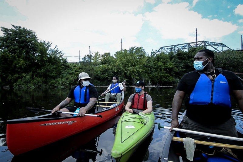 Staff members of the Bronx River Alliance float a section of the Bronx River in the South Bronx during filming for a virtual fundraising event.