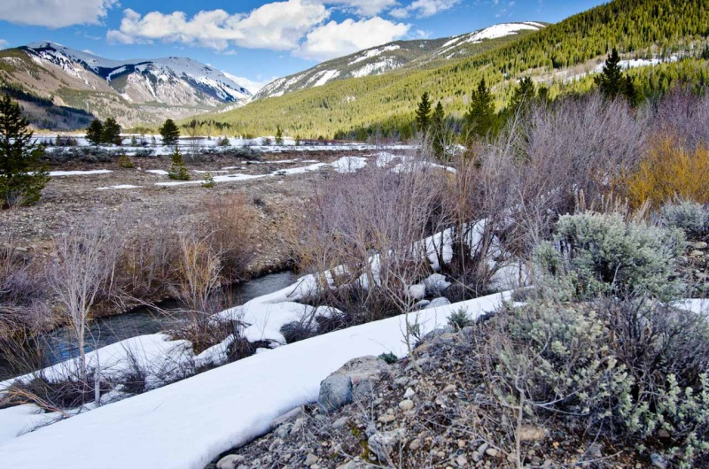 Snow in the riparian zone of the Eagle River with views toward snow covered Sheep Mountain and Kokomo Pass on the Continental Divide.