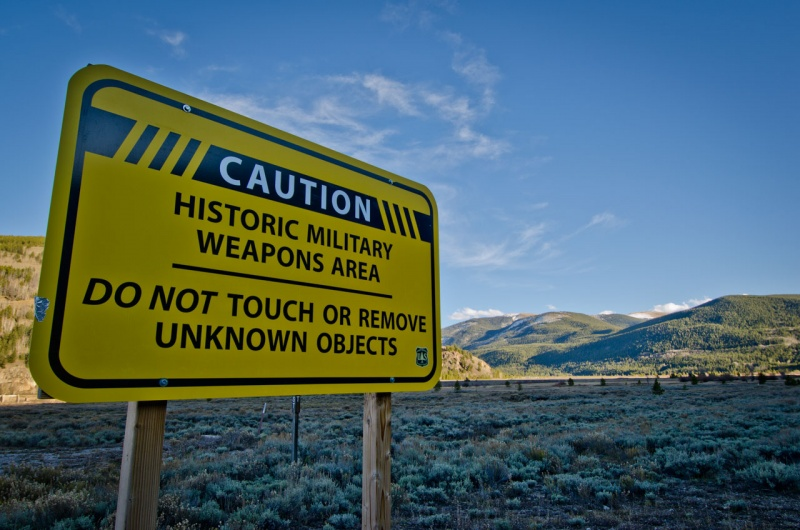 A large sign posted in the former military training facility of Camp Hale warns people about the possible danger of discovering unexploded ordinances in the area.