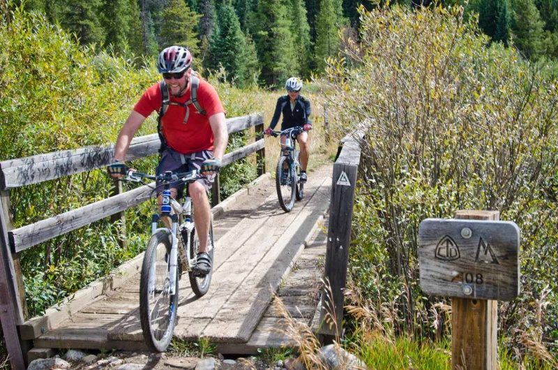 Mountain biking on a section of the 486 mile long Colorado Trail that crosses over the East Fork of the Eagle River through Camp Hale.