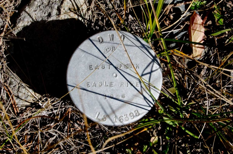 A survey marker on the banks of the East Fork of the Eagle River in Camp Hale.