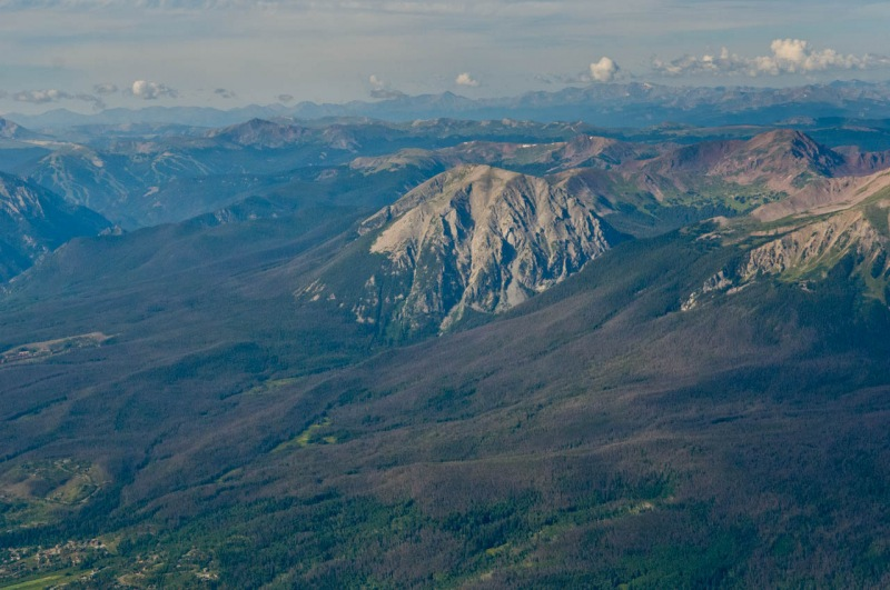 Aerial view of Buffalo Mountain surrounded by forests of lodgepole pine in red phase Mountain Pine Beetle infestation.