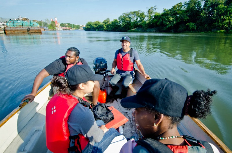 Staff from the Bronx River Alliance heading into the East River for water quality monitoring for the Save the Sound program.