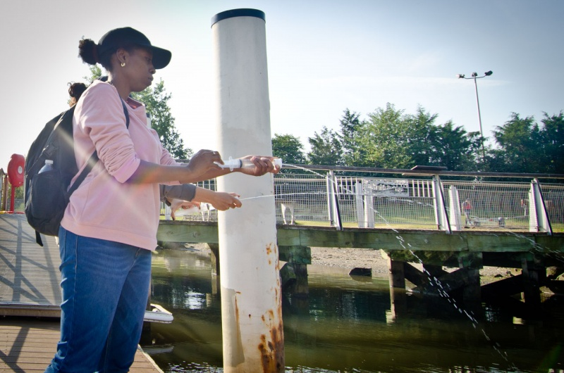 At Hunts Point Riverside Park on the Bronx River, a team from the Bronx River Alliance prepare water quality samples that will be used by Save the Sound to assess the health of Long Island Sound.