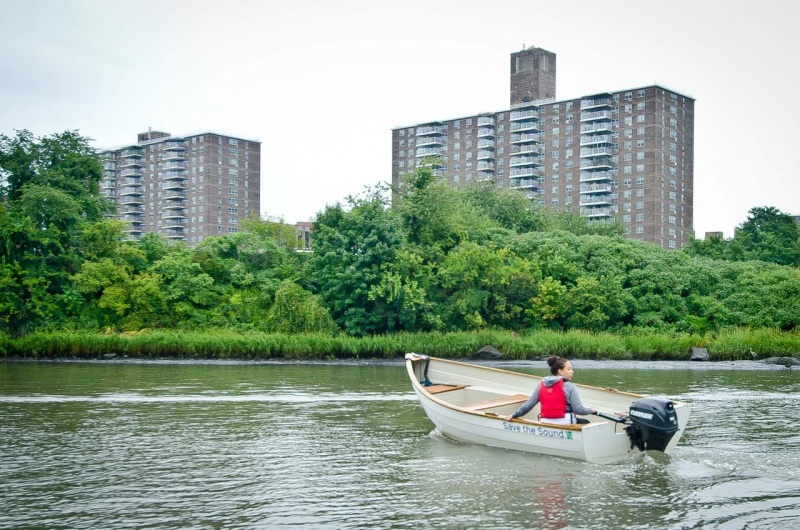 The Recreational Coordinator for the Bronx River Alliance pilots a boat used to collect water samples for a report from Save the Sound on the water quality of Long Island Sound at Hunts Point Riverside Park in the South Bronx.