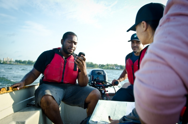 Using GPS, a small crew from the Bronx River Alliance measures and records data that indicates water quality at specific points on the East River that is used for a report from Save the Sound on the water quality of Long Island Sound.
