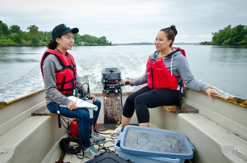 A small team from the Bronx River Alliance navigates the Bronx River near its confluence with the East River during data collection for a report from Save the Sound on the water quality of Long Island Sound.