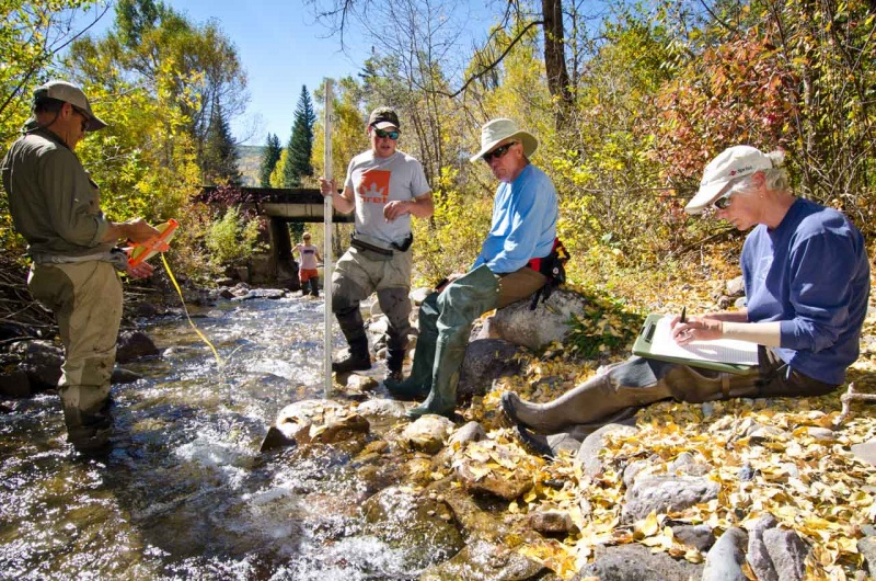 In the field collecting and recording stream data that helps identify suitable habitat for native cutthroat trout within the Eagle River watershed.