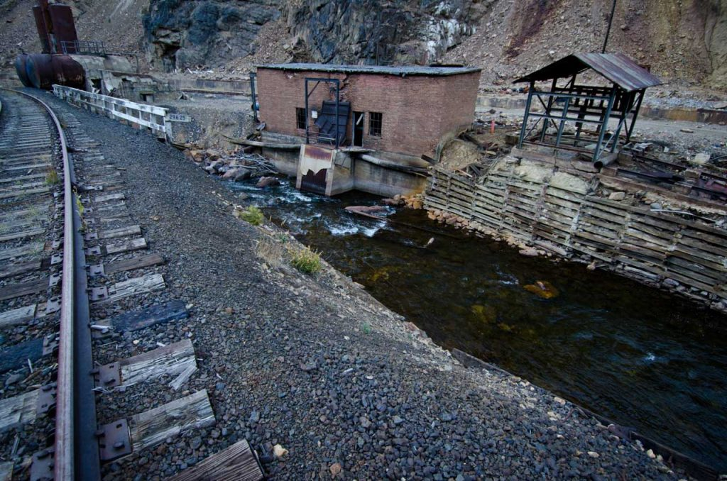 Eagle River Flows By Abandoned Buildings